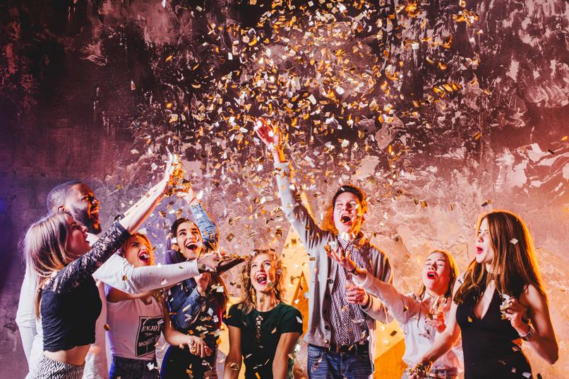 friends-having-fun-falling-confetti